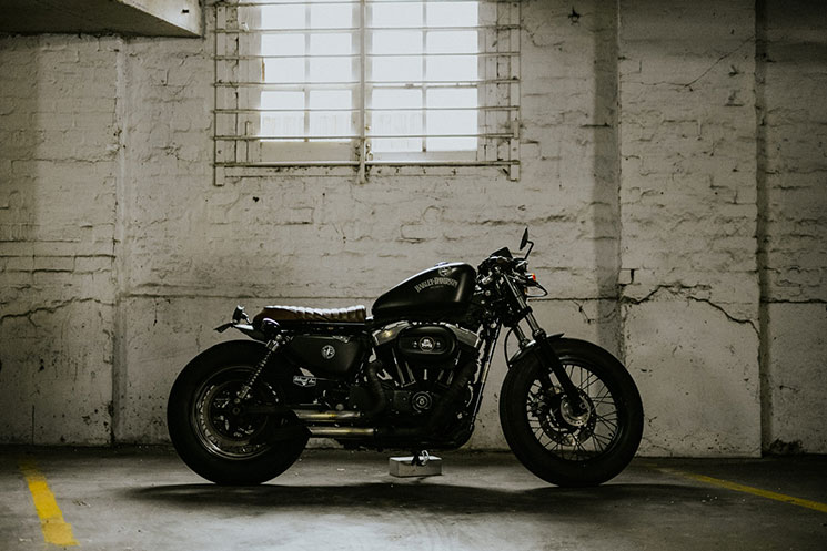 Sportster That Began All White Chrome The Donor Bikes Original Scheme Into A Blacked Out Brat Cafe Bike Turned Heads And Upset Harley Purists